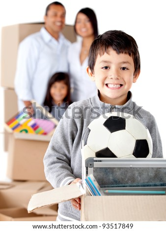 Family moving house and a boy holding a box with toys - isolated over a white background - stock photo