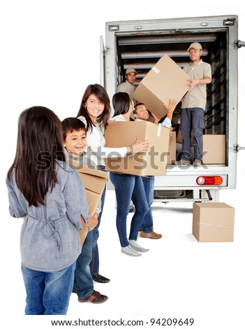 Family moving house and loading a truck with boxes - isolated over white - stock photo