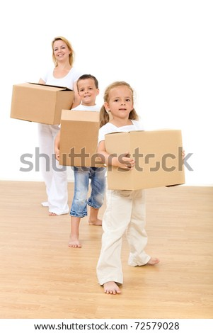 Family moving into a new home - carrying cardboard boxes with kids - stock photo
