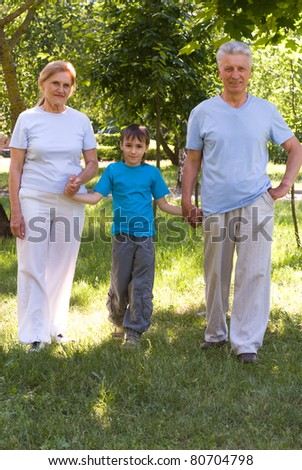 family of a three playing in the park