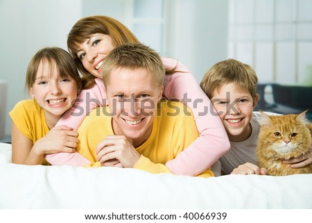 Family of four and a cat playing the fool - stock photo