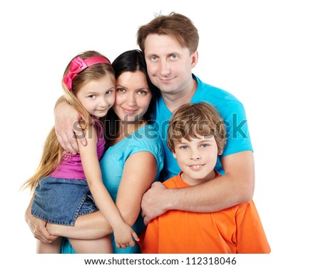 Family of four, father embraces mother, daughter and son - stock photo