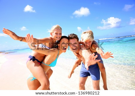 Family of four having fun at the beach