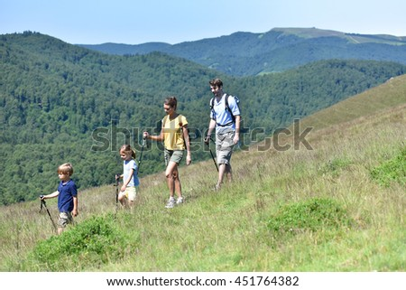 Family of four hiking in the mountain