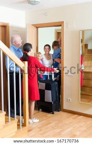 Family of four is coming to kinsmans home - stock photo
