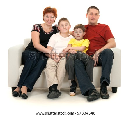 Family of four on a sofa on a white background