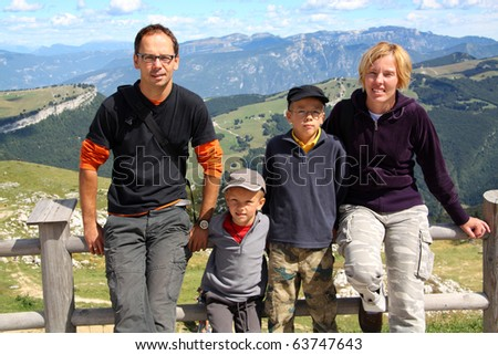 Family of four on their vacation in Monte Baldo, Trentino, Italy - stock photo