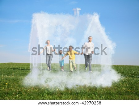 family of four running on grass and dream cloud house collage - stock photo