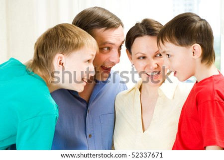 family of four standing together and surprise talks