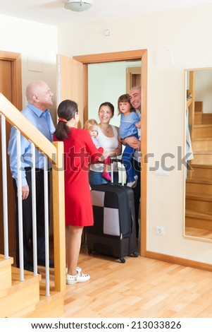 Family of four visiting the kinsfolk home - stock photo