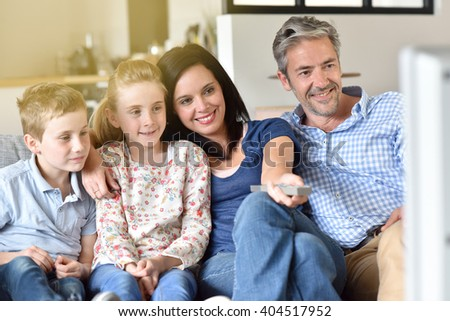 Family of four watching tv