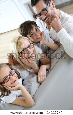 Family of four wearing eyeglasses - stock photo