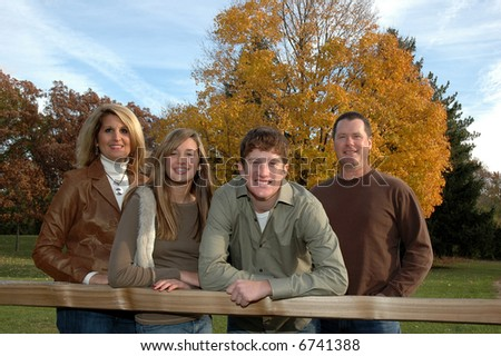 family of four with teenagers - stock photo