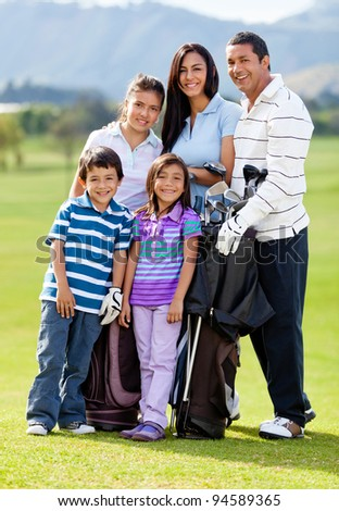 Family of golf players at the course looking happy - stock photo