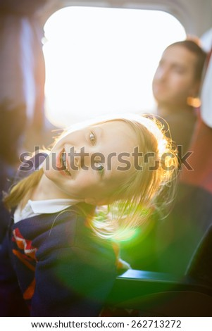 Family of little girl and her father traveling on train - stock photo