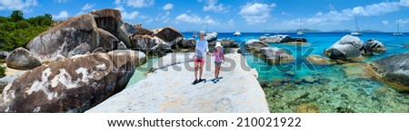 Family of mother and daughter enjoying view of beautiful scenery of The Baths beach area major tourist attraction at Virgin Gorda, British Virgin Islands, Caribbean - stock photo