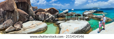 Family of mother and kids enjoying view of beautiful scenery of The Baths beach area major tourist attraction at Virgin Gorda, British Virgin Islands, Caribbean - stock photo