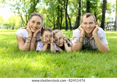 Family of mother, father and children together in the park