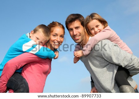 Family of 4 people in countryside - stock photo