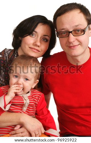 Family of three in red on a white background