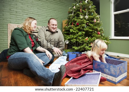 Family of three on Christmas morning
