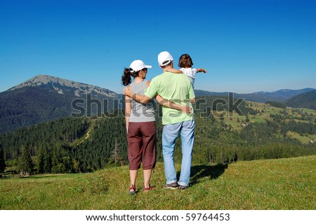 Family of three on their vacation in Carpatian mountains - stock photo