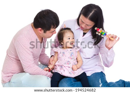 Family of three playing together - stock photo