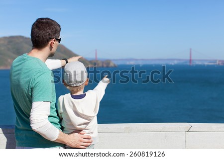 family of two enjoying the view of famous san francisco sightseeing - golden gate bridge - stock photo