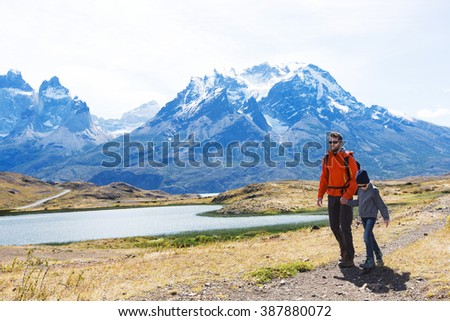 family of two, father and son, enjoying hiking in torres del paine national park, patagonia, chile - stock photo