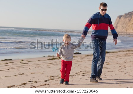 family of two having fun at the beach