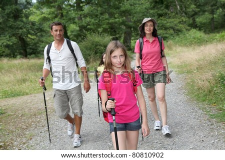 Family on a hiking day - stock photo
