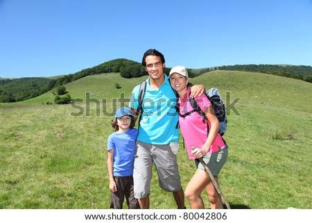 Family on a hiking day in summer - stock photo