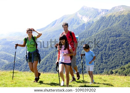 Family on a trekking day in the mountains - stock photo