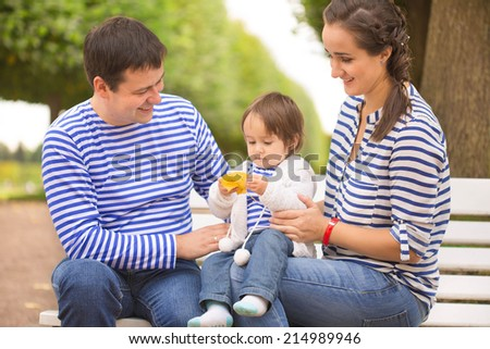 family on bank in the park - stock photo