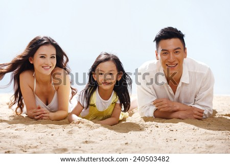 Family on beach - stock photo
