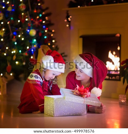 Family on christmas eve fireplace kids stock photo for Best warm places to live with a family