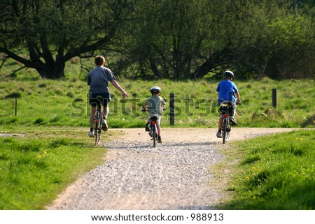 family on cycle on   in a forest path