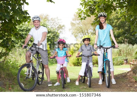Family On Cycle Ride In Countryside - stock photo
