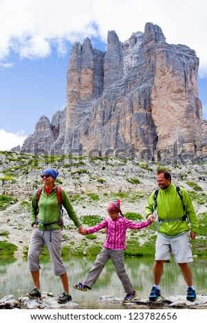 """Family on mountain trek - Tre Cime di Lavaredo """" Drei Zinnen """" - Dolomites - Italy - stock photo"""
