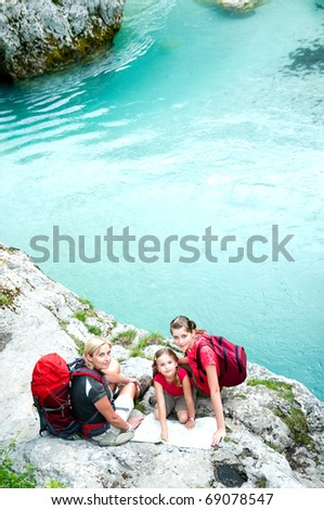 Family on mountains trek - stock photo