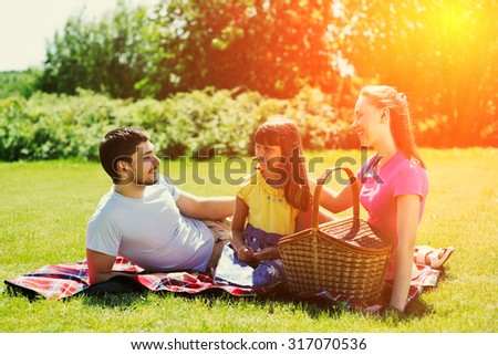 Family on picnic at sunny day - stock photo