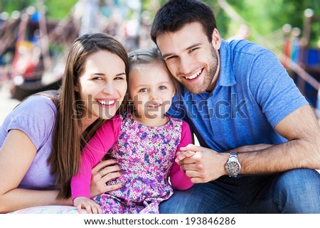 Family on playground  - stock photo