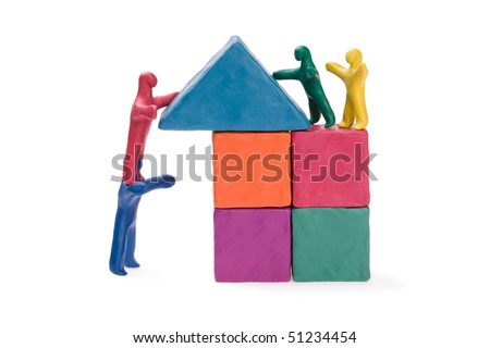 Family on the construction of a house. Plasticine.