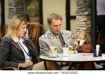 family on the phone - stock photo