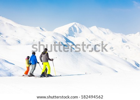 Family on winter ski vacations in ski slopes in Alps, Vogel, Slovenia, Europe. - stock photo