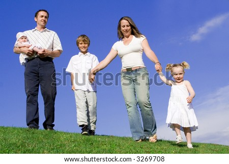 family out for stroll - stock photo
