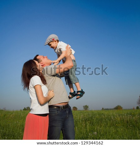 family outdoors, mother, father and son - stock photo