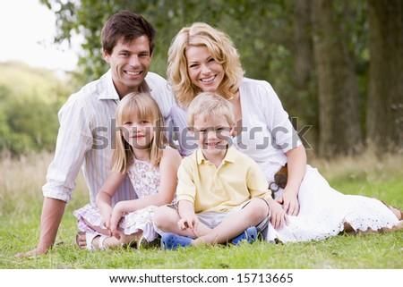 Family outdoors smiling - stock photo