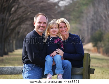 family outside at the park - stock photo