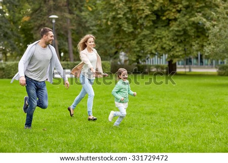 family, parenthood, leisure and people concept - happy mother, father and little girl running and playing catch game in summer park - stock photo